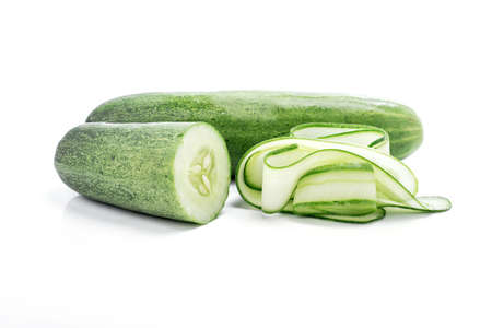 grown: fresh and tasty green vine ripened garden grown cucumber on white background.