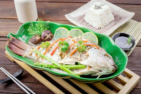 tilapia fish steamed with soy sauce, Thai food.