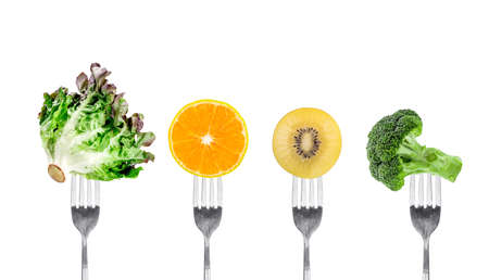 vegetables and fruits on fork isolated on white background Stock Photo
