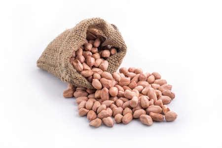 goober peas: Peanut in sacks on white background. Stock Photo