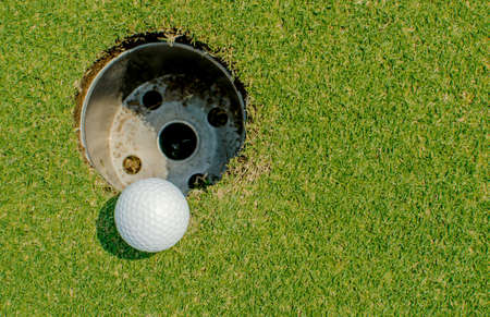 caddie: Golf ball very close to the hole Stock Photo