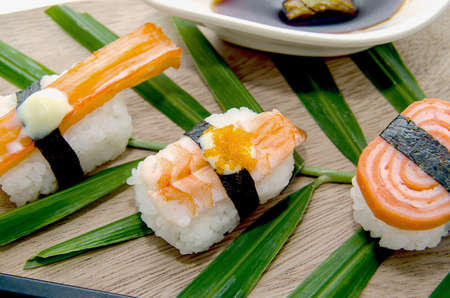 Different types of sushi in the plate isolated on white background Stock Photo