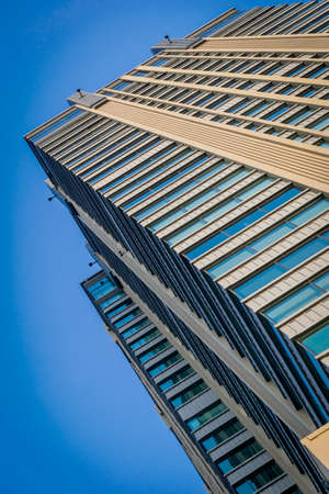 perspective wide angle view blue background of glass high rise building skyscrapers in modern futuristic downtown at Business concept of successful industrial architecture Stock Photo