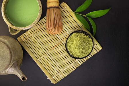 Matcha fine powdered green tea on back background. Stock Photo