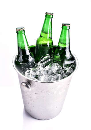 Beer bottles in ice bucket, isolated on white Stock Photo