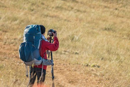 Handsome young professional photographer taking photos, Natural in the morning Stock Photo