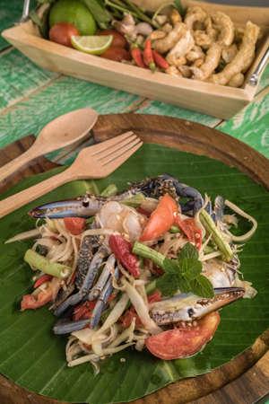 tam: Papaya salad with crab on wood table