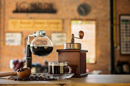 Siphon vacuum coffee maker on cafe bar Stock Photo
