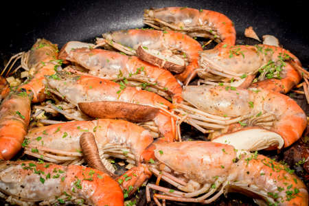 Baked king prawns in pan, Heap of baked shrimps