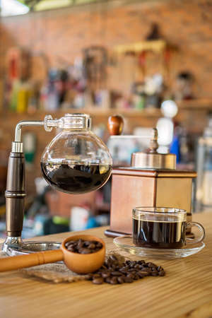 gasket: Siphon vacuum coffee maker on cafe bar Stock Photo