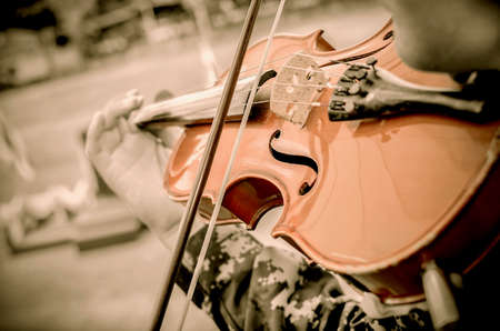 Hand on the strings of a violin Stock Photo