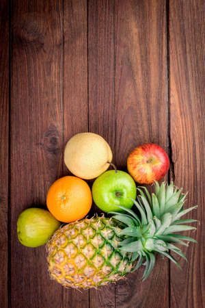 Fruits on background wooden table
