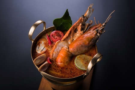 Close up Asian Spicy soup with shrimp in bowl , famous Thai food cuisine calling Tom Yum Kung Stock Photo - 87180031