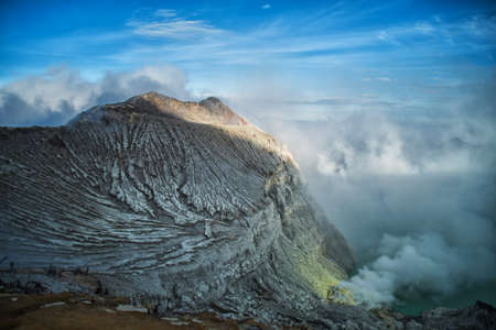 Lake and Sulfur Mine at Khawa Ijen Volcano Crater, Java Island, Indonesia Stock Photo