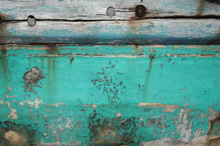 uñas pintadas: Old wooden boat wall background, Close up of wall with layers of chipping paint flakes Foto de archivo