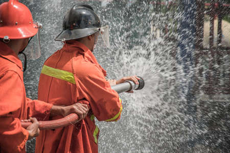 Firefighters rehearse fire fighting plans at LPG storage facilities. Thailand. Stock Photo