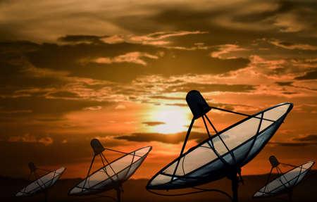 satelite: Big black Satellite Dish on sunset background Stock Photo