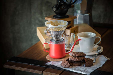 breakfast with coffee dripping in the morning. Still life photograph, Kit for making drip coffee in vintage color tone