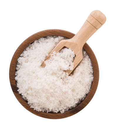 salt crystals in wooden bowl on white background. Stock Photo