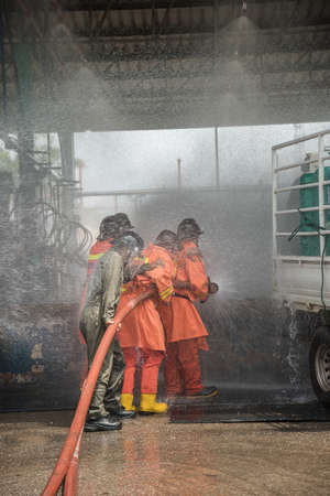 Firefighters rehearse fire fighting plans at LPG storage facilities. Thailand. Editorial