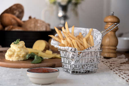 French fries dish and some food on the table. Stock Photo