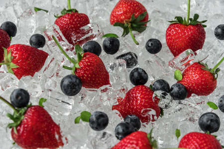 Strawberry with blueberries on ice