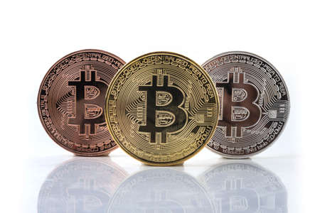 Bitcoin. Physical bit coin. Digital currency. Cryptocurrency. Golden coin with bitcoin symbol isolated on white 版權商用圖片