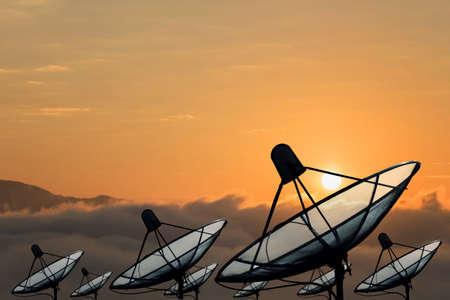 Big black Satellite Dish on sunset sky background