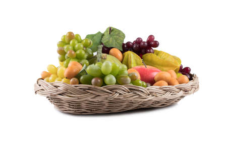 Ripe fresh fruit in basket isolated on white background