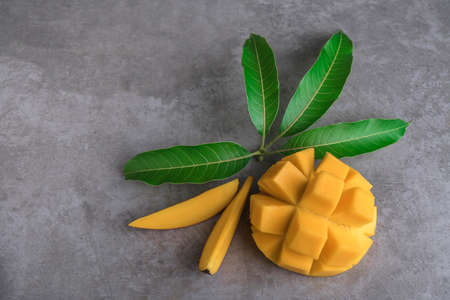 mango on a dark background, tinting selective focus on the mangos slices