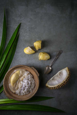 Sweet Sticky Rice With Durian And Coconut Milk Sauce, Thai food.