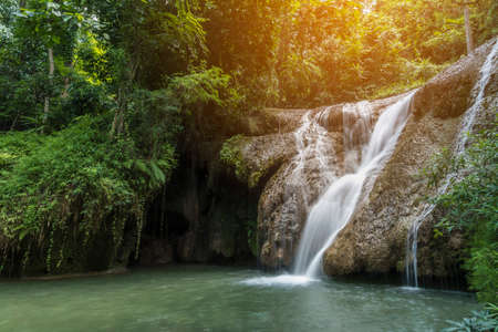 soft water of the stream in the natural park, Beautiful waterfall in rain forest (Tran Sawan Waterfall, Thailand) Banco de Imagens