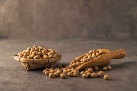 healthy soybean on dark background in wooden spoon Stock Photo