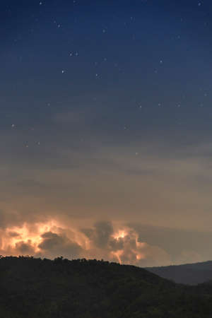 Thunderstorm Clouds with Lightning, Lightning with dramatic clouds (composite image). Night thunder-storm Stock Photo
