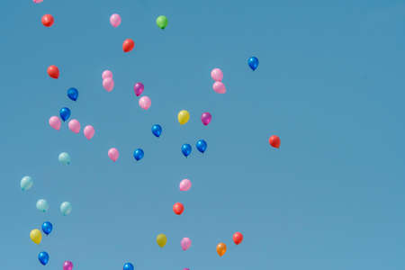 Rubber balloon with blue sky, rainbow ballons in the sky