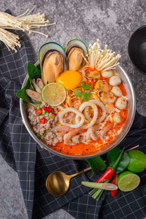 Tom yum kung. Thai food style Seafood Hot Pot. Traditional Thai style food. Stock Photo - 124520566
