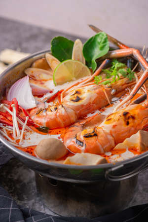 Tom yum kung. Thai food style Seafood Hot Pot. Traditional Thai style food. Stock Photo - 124520573