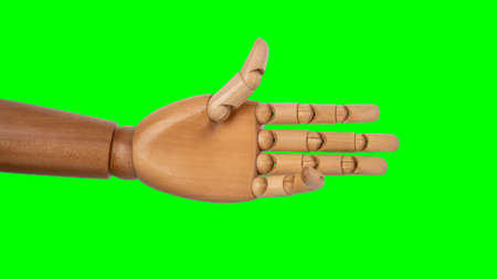 Wooden hand isolated on green background Stock Photo