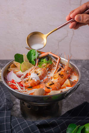 Tom yum kung. Thai food style Seafood Hot Pot. Traditional Thai style food. Stock Photo - 124526370