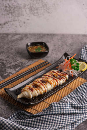 Grilled squid with teriyaki sauce 스톡 콘텐츠