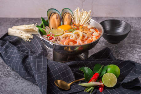 Tom yum kung. Thai food style Seafood Hot Pot. Traditional Thai style food.