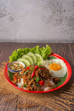 Rice topped with stir-fried pork, basil and fried egg. fried stir basil Stock Photo