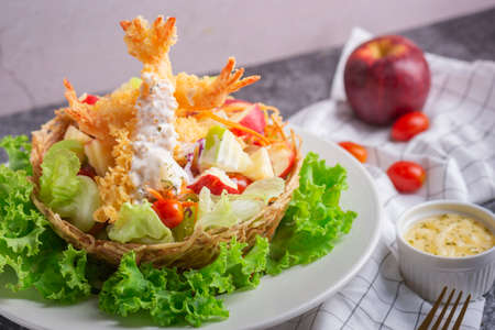 Tempura Jumbo Shrimps with salad and salsa dip on white plate.