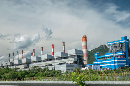 Power Plant With Park Nature Mountain And Lake Green Good Environment At Mae Moh Steam Power Station, Thermal Power Plant. Mae Moh Coal Power Plant In Lampang Thailand.