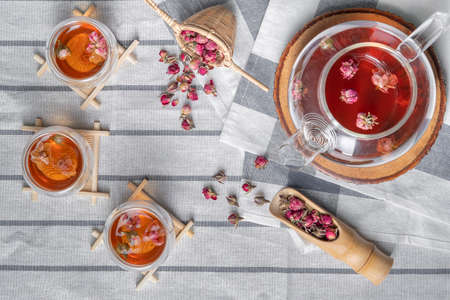 ttea made from tea rose petals in a glass bowl on table, Concept tea time.