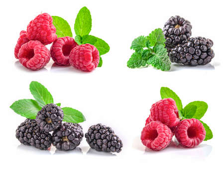 Raspberries and blackberries in closeup isolated on white background.