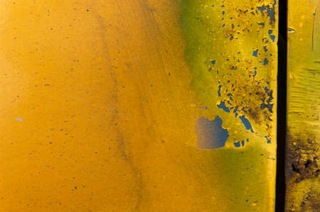 Scrapped paint and scratches on metal surface. Metal surface painted yellow. The mild gradient between yellow and almost green colors. Colorful warm texture Reklamní fotografie