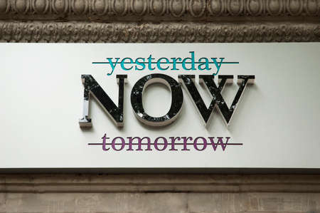 Crossed out words yesterday and tomorrow banner praising the moment of now