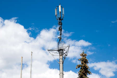 Telecommunication mast television antennas.Telecommunication GSM.Receiving and transmitting stations.Phone mast satellite 4g cell tower.Mobile phone antenna, telecommunication tower with clouds Stockfoto