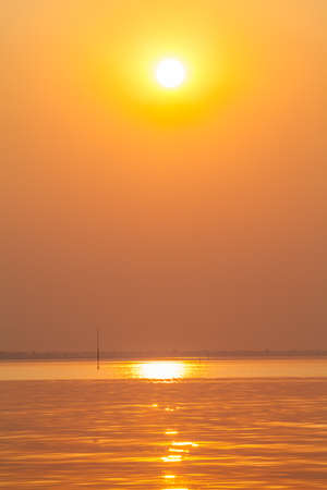 billow: Beautiful Golden Sun Set in The Middle of The Ocean Stock Photo